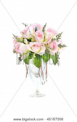 rose in glass pot