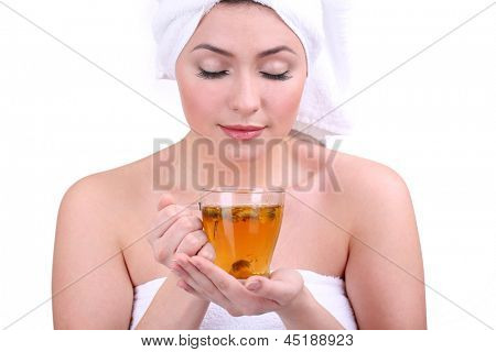 Beautiful young woman with cup of herbal tea isolated on white