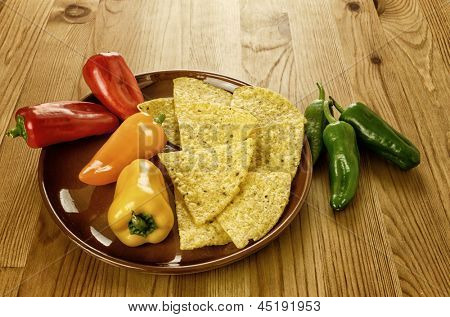 Raw Mexican food, nachos and colorful peppers