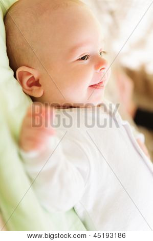 Cute Newborn Baby Smiling In Bed