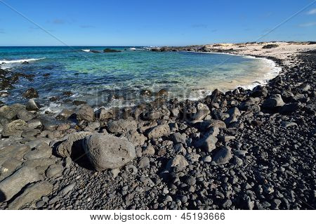 Stone Beach On Canary Islands, Lanzarote. Spain.