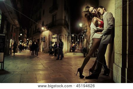 Passionate lovers over night city background