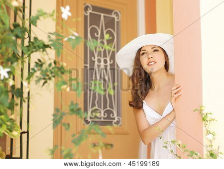 Young and beautiful lady walking down the ancient street