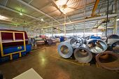 LOBNYA - JUN 7: Metal coils in manufacturing workshop at plant of Group of companies Metal Profile,