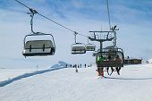 Chair Lift With Three Skiers