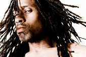 picture of dreadlock  - portrait of a skeptical man with dreadlocks - JPG