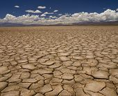 foto of drought  - Large field of baked earth after a long drought - JPG