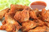 stock photo of fried chicken  - chicken wings with hot spicy barbecue sauce - JPG