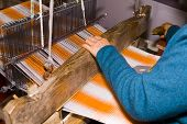 picture of handloom  - a Weaver at the old loom in china  - JPG