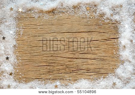 christmas snow decoration on wooden background