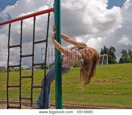 Girl On Playground Equipment