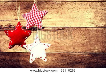 Christmas Decoration Hanging Over Rustic Wooden Background. Vintage Christmas Card. Festive Red Star