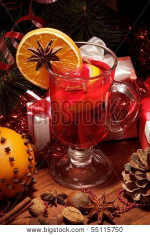 Glass of mulled wine with orange