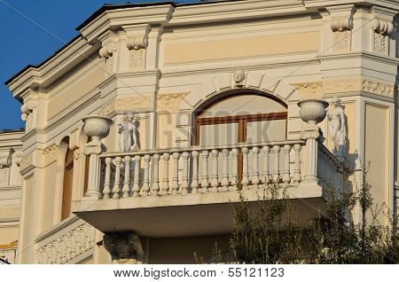 House With Statues