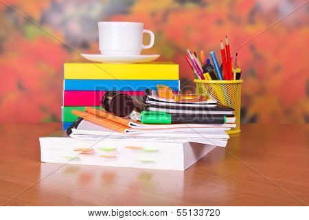 Books, cup with a saucer and writing-materials