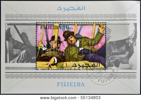 stamp printed in Fujeira shows the famous movie comedy duo of Stan Laurel and Oliver Hardy