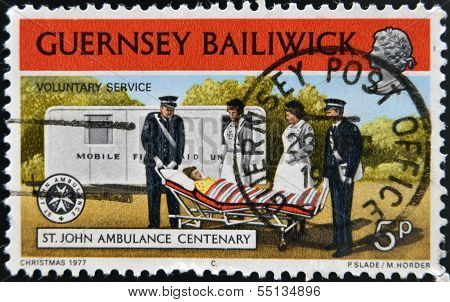 tamp printed in Guernsey dedicated to St. John Ambulance Centenary shows voluntary service