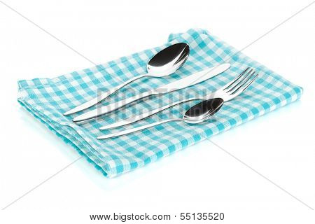 Silverware or flatware set of fork, spoons and knife on towel. Isolated on white background