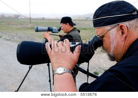 Two Ornithologists Watching Through Telescopes