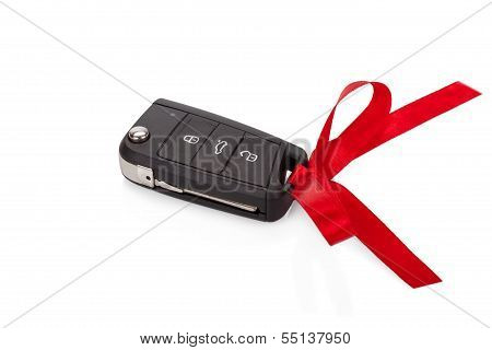 Gift Idea: Car Keys With Red Ribbon Isolated On White Background
