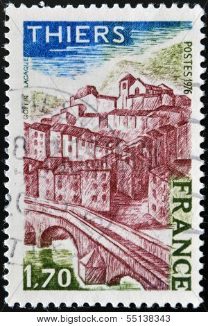 A stamp printed in France shows image of Thiers village