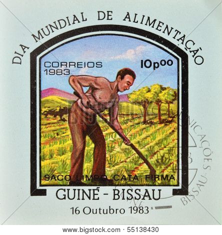 stamp commemorative the world food day showing a farmer plowing the land
