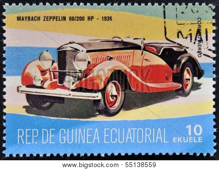stamp printed in Guinea dedicated to vintage cars shows Maybach Zeppelin 60/200 HP 1936