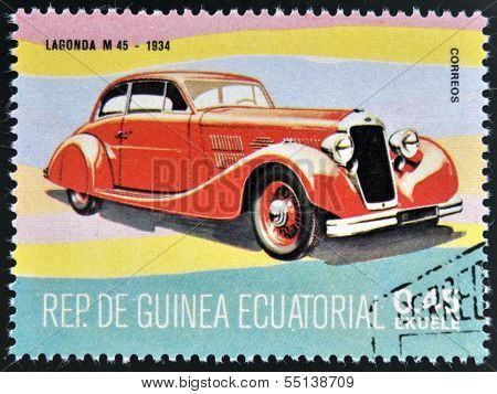 A stamp printed in Guinea dedicated to vintage cars shows Lagonda M 45 1934