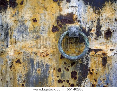 decaying rusty door at Pere Lachaise Cemetery in paris narrow DOF