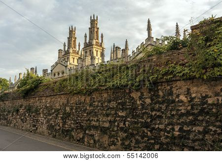 All Soul's College Hidden Behind High Stone Wall Covered With Ivy, Oxford, England