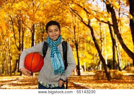 Black Boy With Ball In Park