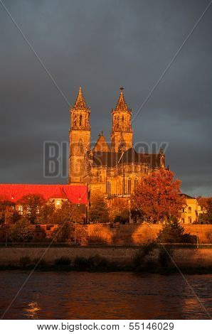 Golden Cathedral Of Magdeburg And The River Elbe At Sunrise