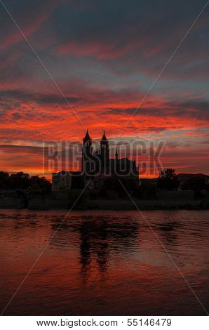 Cathedral Of Magdeburg And The River Elbe At Sunset