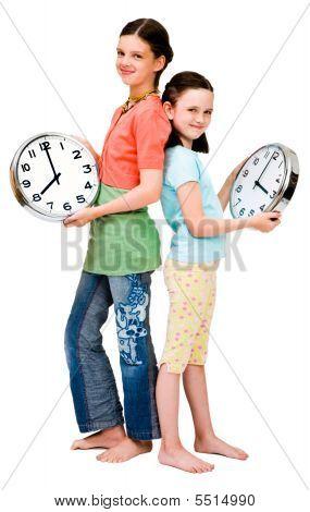 Cute Girls Holding Clocks