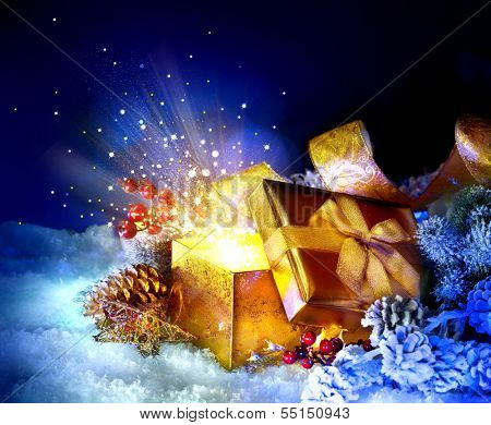 Christmas Gift Box with miracle. Magic Stars and Light. Winter Holiday Art Background with Snow and Gifts. Present Box. New Year Open gift box and magic light fireworks