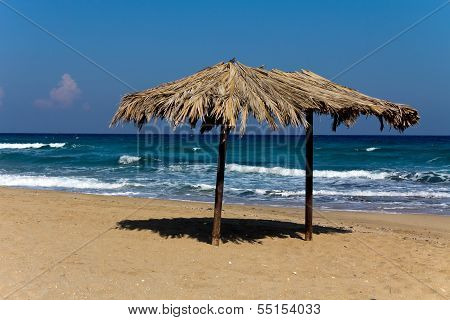 Big Tropical beach with umbrella in Cyprus