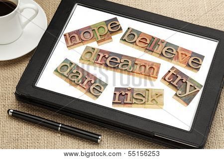 dream, hope, believe, dare, risk, try - a set of motivational and spiritual  words in vintage wood letterpress printing blocks on a digital tablet