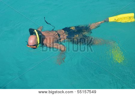 Snorkler With Yellow Swim Fins