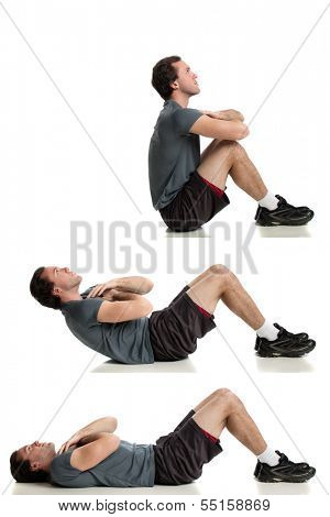 Young adult man doing sit ups. Studio shot over white.