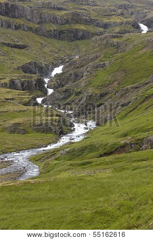 Iceland. East Fjords. Landscape With River And Mountains.