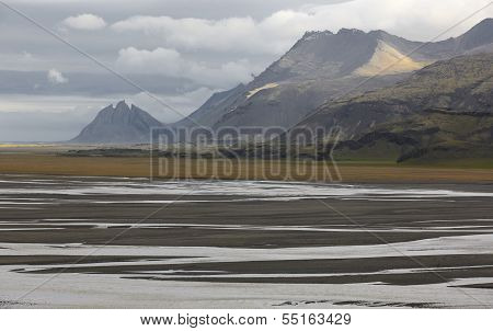 Plain Formed Of Glacial Sediments With Water And Sand