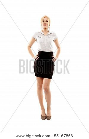 Young Cheerful Businesswoman Standing Akimbo