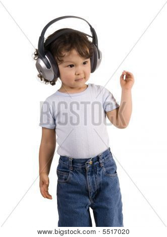 Child With Headphones,isolated On A White Background.