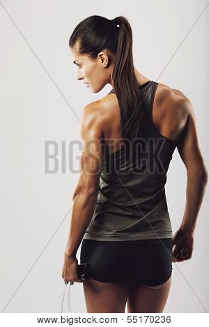Female Bodybuilder Holding Skipping Rope