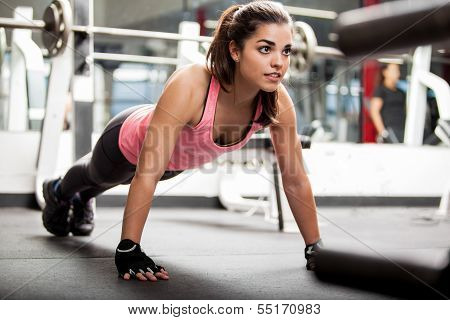 Cute brunette working out at a gym