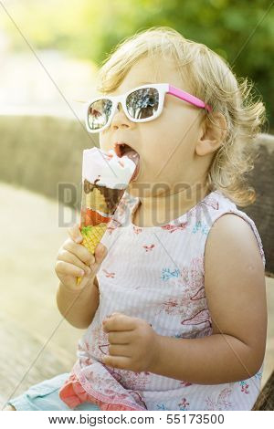 Cute Baby Girl Eating Ice Cream