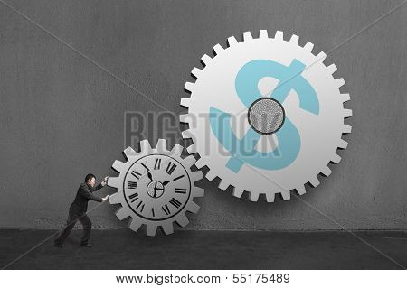Businessman Rolling Large Concrete Gears With Clock And Money Symbol Drawing In Concrete Wall Backgr