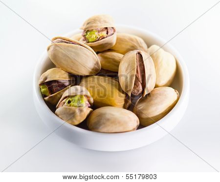 Pistachio. Heap of unpeeled nuts isolated on white background