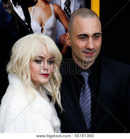 NEW YORK-DEC 8: Actors Taryn Manning (L) and Jay Giannone attend the