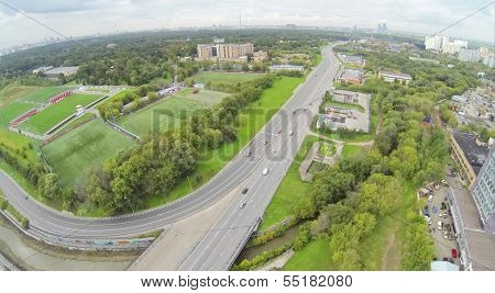 Road and with football fields at cloudy day. View from unmanned quadrocopter.